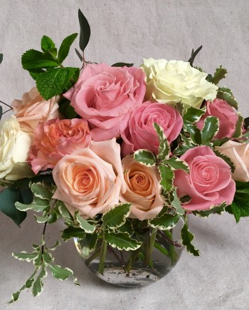 Flowers Online: The Timeless Rose Classic vase includes premium roses in shades of peach and pink accented with fragrant greens.