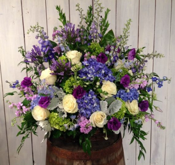 Sympathy & Funeral Flowers: Amethyst Basket is our signature style basket arrangement with hydrangea, delphinium and roses.