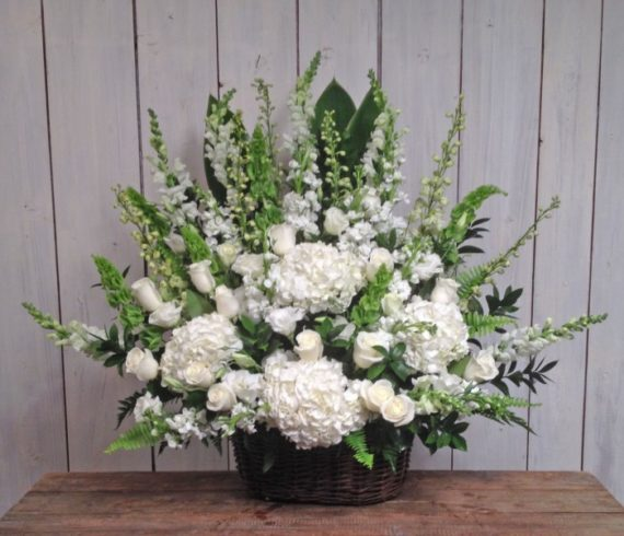 Sympathy & Funeral Flowers: The Classic White Basket includes premium white blossoms arranged in our traditional design for a soft elegant statement.