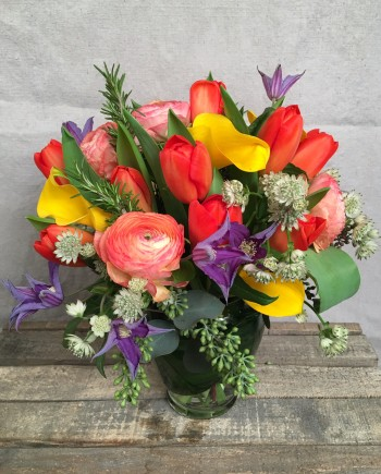 Flowers Online: Our Morocco vase arrangement includes vibrant yellow calla lilies, purple clematis, bright orange seasonal blooms and more.