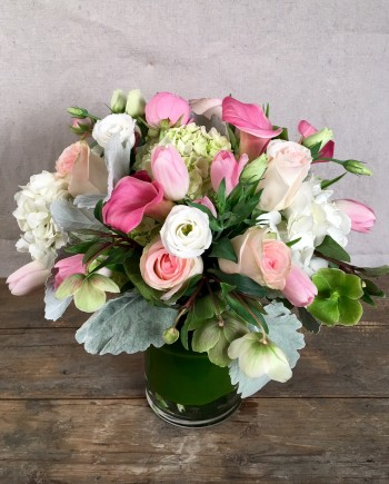 Flowers Online: Blush Kiss vase is a gathering of softly shaded premium blossoms including ranunculus, lismachia, hellebores, calla lilies and a variety of roses.