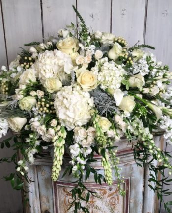 Sympathy & Funeral Flowers: The Linen and Lace Blanket is a cascade of premium blooms on a lush bed of greens, understated and elegant.