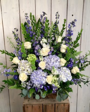 Sympathy & Funeral Flowers: The Oceanview basket is our signature style basket arrangement of roses, hydrangea and delphinium accented with seasonal foliage.