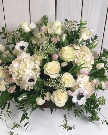 Sympathy & Funeral Flowers: The English Country Basket includes roses, hydrangea and seasonal blooms with premium greens arranged in a lower less-traditional style.