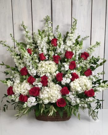 This stately sympathy basket of red roses is accompanied by a variety of premium white blooms.