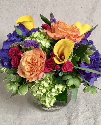 Flowers Online: Picasso vase arrangement includes dutch hydrangea, vibrant yellow calla lilies, hot pink spray roses, orange roses and more.